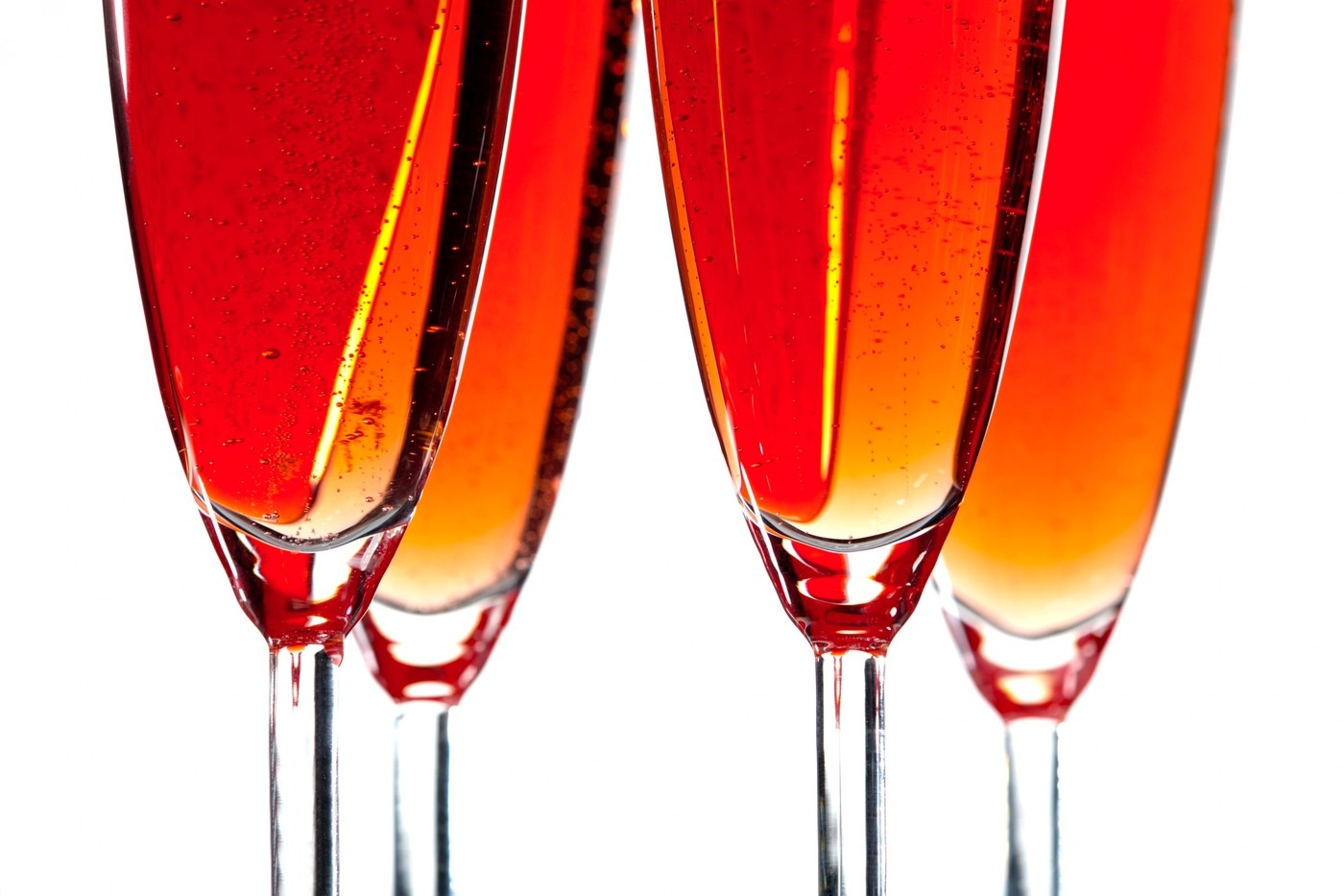 Close-up of champagne flutes against white background