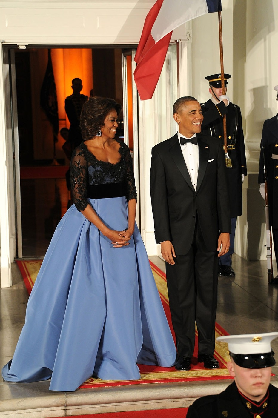 US President Barack Obama and first lady Michelle Obama wait for the arrival of French President Francois Hollande for a state dinner at the White Hou