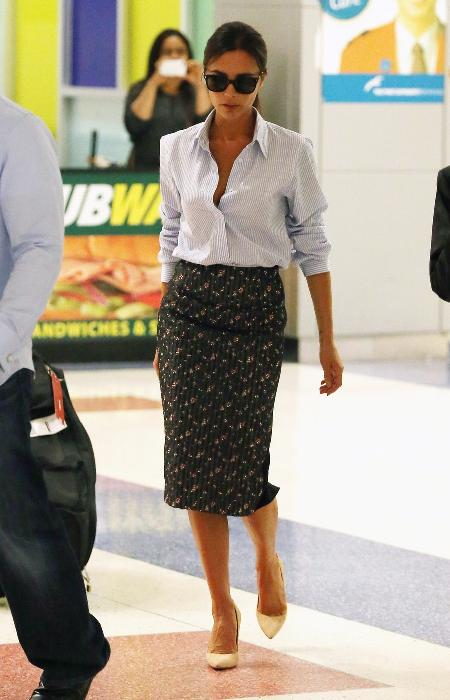 Victoria Beckham jets into JFK airport in New York. The ever stylish Victoria turned the airport into her catwalk as she walked through the terminal a