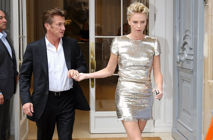 Charlize Theron and Sean Penn seen leaving Dior showroom