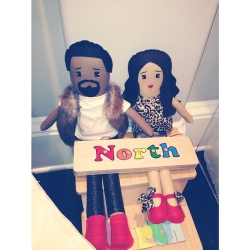 North plays with dolls of parents; Kim wears North's name on hands